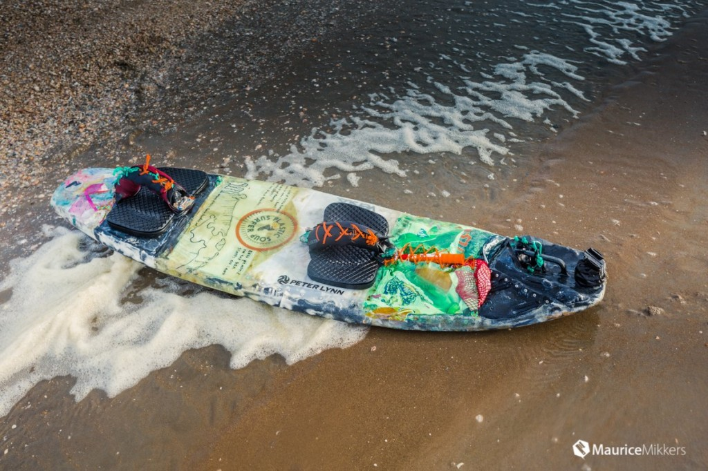 surf board made from plastic garbage found on the beach